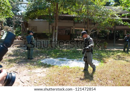 YALA, THAILAND - FEB 23: Explosive Ordnance Disposal Police search for time bomb after time bomb explode on Feb 23, 2012 at Yaha Samukkee School Yala, Thailand