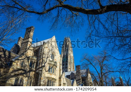 Yale university buildings in winter sunlight with snow and blue sky - stock photo