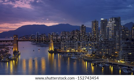 Yaletown and the Burrard Bridge in False Creek in the city of Vancouver, British Columbia in Canada. - stock photo
