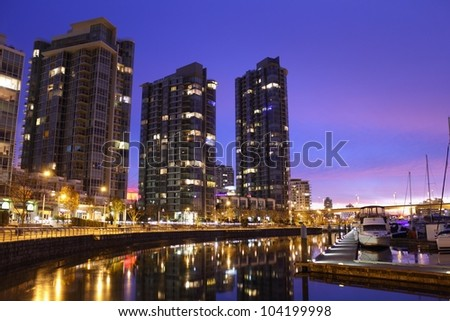 Yaletown Dawn, False Creek, Vancouver. The cool early morning light strikes the Yaletown condominiums on the edge of False Creek in downtown Vancouver. British Columbia, Canada. - stock photo