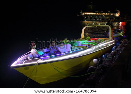 YALTA - AUG 23: Boat glowing colored lights waiting for tourists for the sea walk on August 23, 2013 in Yalta, Ukraine.  - stock photo