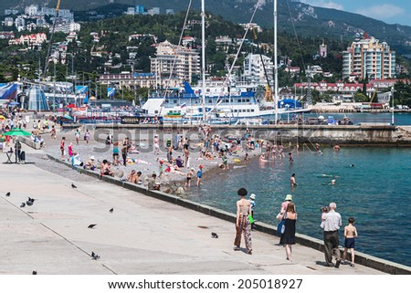 YALTA - June 10, 2014: People relax and swim at the beach in Yalta. Yalta resort town in the southern Crimea.