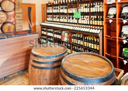 YALTA, RUSSIA - SEPTEMBER 2, 2014: local  wine shop in Yalta, Crimea. Winemaking in Crimea has existed for over two thousand years, now prices of  local wines on tap are 4 - 5 dollars per liter - stock photo