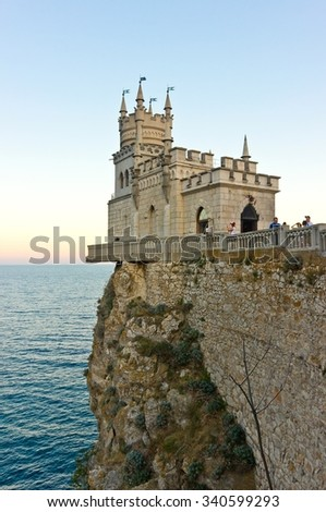 YALTA, RUSSIA - SEPTEMBER 19, 2015: People looking at sunset from famous landmark castle Swallow's Nest near Yalta. Crimea