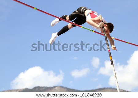 YALTA, UKRAINE - APRIL 25: Haletski Rostislav compete in the pole vault competition for boys age 16-17 on Ukrainian Junior Track and Field Championships on april 25, 2012 - Yalta, Ukraine. - stock photo