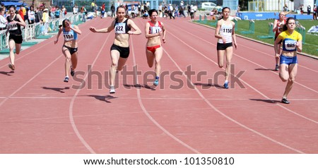 YALTA, UKRAINE - APRIL 25: Unidentified girls age 16-17 on the 100 meters race on Ukrainian Junior Track and Field Championships on April 25, 2012 in Yalta, Ukraine.