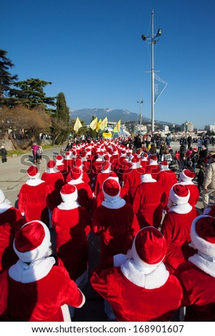 YALTA, UKRAINE - DECEMBER 21: Santas participate in the Santa Claus parade on Dec.21, 2013 in Yalta, Ukraine. This parade is held every year.
