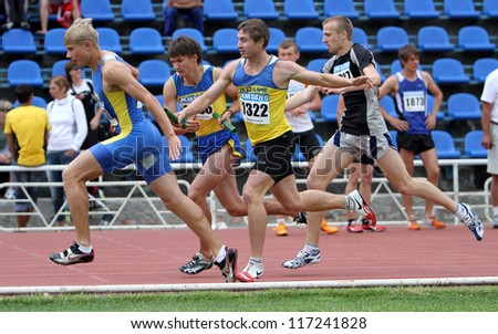 YALTA, UKRAINE - JUNE 02:Unidentified men at the relay race on the Ukrainian Track & Field Championships on June 02, 2012 in Yalta, Ukraine - stock photo