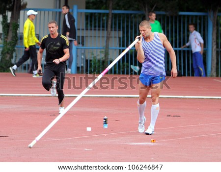 YALTA, UKRAINE, MAY 28: Denys Yurchenko competes on the Ukrainian Cup in Athletics, on May 28, 2012 in Yalta, Ukraine. He won bronze medal in the pole vault event at Summer Olympics in Beijing.