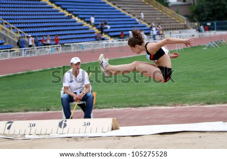 YALTA, UKRAINE - MAY 24: Kashits Aliona competes in the long jump on the international athletic meet between UKRAINE, TURKEY and BELARUS on May 24, 2012 in Yalta, Ukraine.