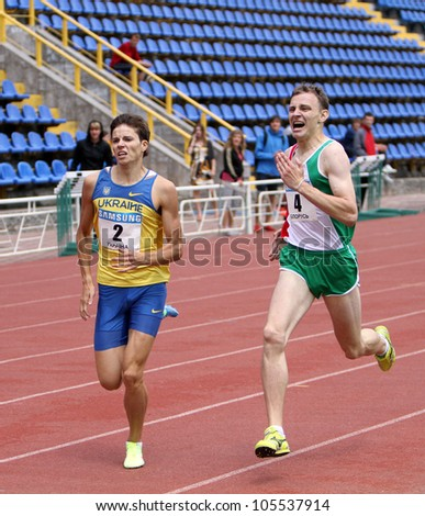 YALTA, UKRAINE - MAY 25: (L-R) Aleksandr Karpenko and Yan Sloma compete in 800 meters race on international athletic meet between UKRAINE, TURKEY and BELARUS on May 25, 2012 in Yalta, Ukraine. - stock photo
