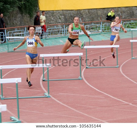 YALTA, UKRAINE, MAY 28: (L-R) Lebed Anastasia, Titimets Anna, Siniachenko Yulia  compete at the 400 meters hurdles race on Ukrainian Cup in Athletics, on May 28, 2012 in Yalta, Ukraine . - stock photo