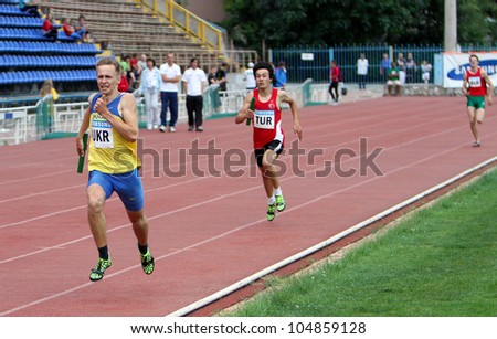 YALTA, UKRAINE - MAY 25: (L-R) Pozdniakov Oleksei, Altintash Batuhan, Lipovka Maksim on relay race on the international athletic meet between UKRAINE, TURKEY, BELARUS on May 25, 2012 in Yalta, Ukraine - stock photo