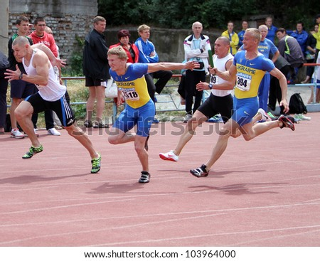 YALTA, UKRAINE, MAY 29: (L-R) Smelik Sergei and Bodrov Igir at the relay race on Ukrainian Cup in Athletics, on May 29, 2012 in Yalta, Ukraine - stock photo