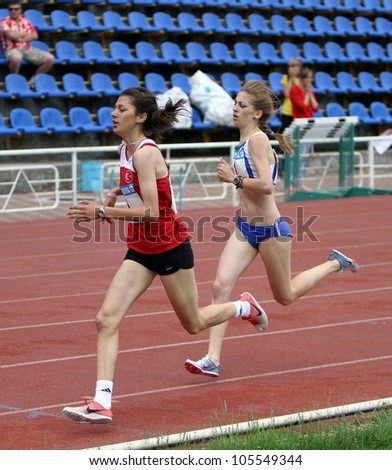 YALTA, UKRAINE - MAY 25: (L-R) Tuna Emine, Tsarik marina compete on the 800 meters race on the international athletic meet between UKRAINE, TURKEY and BELARUS on May 25, 2012 in Yalta, Ukraine. - stock photo