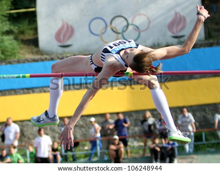 YALTA, UKRAINE, MAY 27: Olena Holosha wins the high jump competition with  Olympic standard - 1.95 on Ukrainian Cup in Athletics, on May 27, 2012 in Yalta, Ukraine. - stock photo
