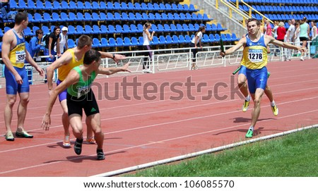 YALTA, UKRAINE - MAY 28: Unidentified men at the relay race on Ukrainian Cup in Athletics on May 28, 2012 in Yalta, Ukraine. - stock photo