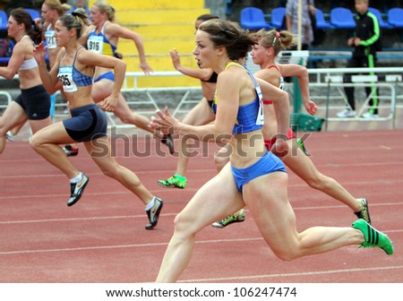 YALTA, UKRAINE - MAY 28: Unidentified women compete in 100 meters race on Ukrainian Cup in Athletics on May 28, 2012 in Yalta, Ukraine. - stock photo