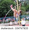 YALTA, UKRAINE - MAY 24: Zuzina Olga competes in pole vault competition for girls +17 on the international athletic meet between Ukraine, Turkey, Belarus on May 24, 2012 in Yalta, Ukraine . - stock photo