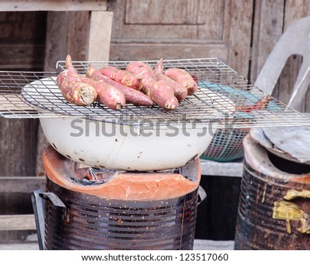 Yam  grilled on the small stove in rural of Thailand.