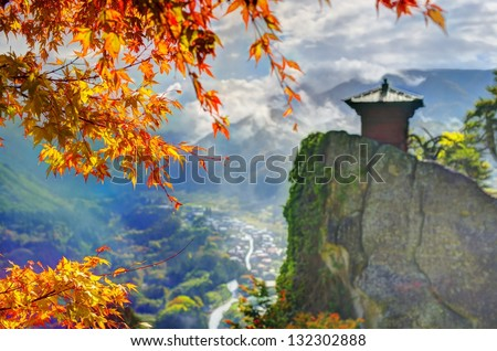Yamadera is a mountain temple. selective focus on foreground fall leaves. - stock photo