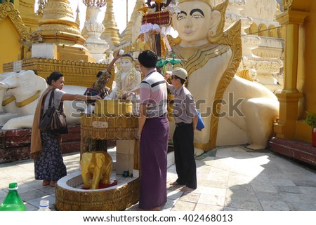 YANGON, BURMA - FEB 18, 2015 - Offering of holy water at planetary post, name day, shrine, Shwedagon Pagoda Yangon (Rangoon),  Myanmar (Burma)