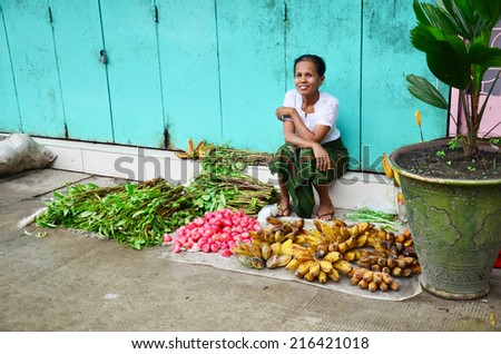 YANGON, BURMA - JULY 12 :  Burmese Woman selling fruit and vegetable at Oxen Market on July 12, 2014 in yangon Myanmar - stock photo
