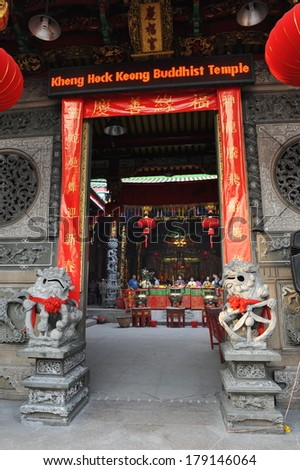 YANGON, CHINA - FEB 10: View of the Front Entrance of the landmark Kheng Hock Keong shrine as temple-goers gather inside during festivities welcoming in the Chinese New Year on Feb 10, 2013 in Yangon, Burma. - stock photo