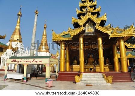YANGON - FEB 12: View of the exterior of Shwedagon Pagoda on Feb 12, 2013 in Yangon, Burma. Built between 6th and 10th century the landmark Shwedagon is considered Burma's most sacred Buddhist temple. - stock photo