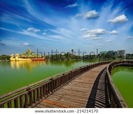 Yangon icon landmark and tourist attraction:  Karaweik - replica of a Burmese royal barge at Kandawgyi Lake and Kandawgyi Nature Park, Yangon, Myanmar (Burma) - stock photo