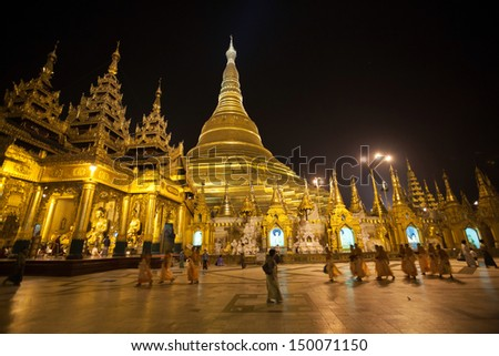 YANGON, MYANMAR - APRIL 3 : Shwedagon Pagoda at night on April 3, 2012. It's 99 metres and has existed for more than 2,600 years, making it the oldest historical pagoda in Myanmar and the world.