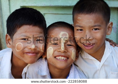 YANGON - MYANMAR - DECEMBER 3, 2013: Unidentified Burmese boys on December 3, 2013 in Yangon, Myanmar. In 2012 an ongoing conflict started between Buddhists and Muslims in Myanmar. - stock photo