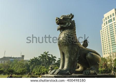 YANGON, MYANMAR - FEB 14, 2016: Statue of Chinthe (halt lion halt dragon) in the Maha Bandula Park in Yangon (Rangoon) in Myanmar (Burma). - stock photo