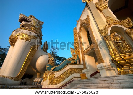 YANGON,MYANMAR-FEBRUARY 6 : Large lion guardians statue at entrance to Shwedagon Pagoda on February 6,2014 in Yangon city,Myanmar.Shwedagon Pagoda is the important ,famous and biggest in Myanmar. - stock photo