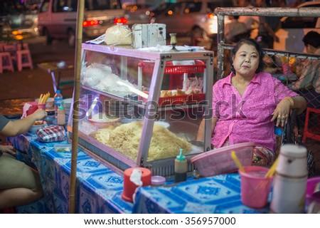 YANGON, MYANMAR â?? FEBRUARY 9: Night market on Maha Bandoola Road in Chinatown on February 9, 2014 in Yangon. Myanmar is ethnically diverse with 51 million inhabitants belonging to 135 ethnic groups. - stock photo