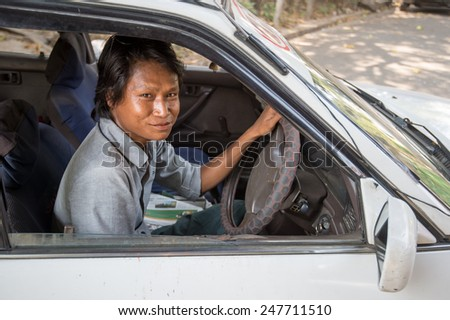 YANGON, MYANMAR - FEBRUARY 10: Portrait of a Burmese taxi driver on February 10, 2014 in Yangon. Myanmar is ethnically diverse with 51 million inhabitants belonging to 135 ethnic groups. - stock photo