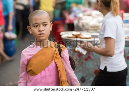 YANGON, MYANMAR - FEBRUARY 5: Portrait of a young Burmese Buddhist nun on February 5, 2014 in Yangon. Burmese Buddhist nuns are called Bhikkhuni and they wear pink robes.