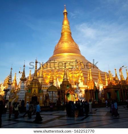 YANGON, MYANMAR - JANUARY 03: Unidentified pilgrims on the trail around golden Shwedagon Pagoda during Shwesettaw Festival on January 03, 2011 in Yangon, Myanmar - stock photo