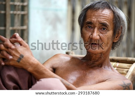 YANGON, MYANMAR - JUNE 12 2015: on one of the hottest recorded days before monsoon season in Yangon, Myanmar. - stock photo