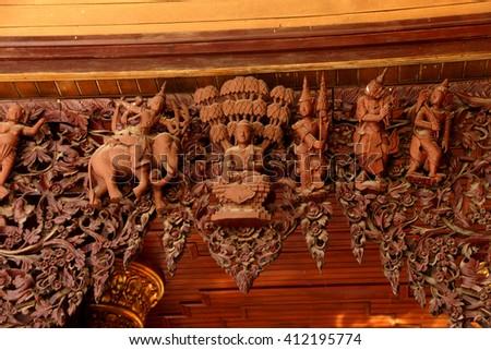 YANGON, MYANMAR - MAR 18, 2015 - Elaborate wood carvings on arch of a temple at the Shwedagon Pagoda,  Yangon (Rangoon),  Myanmar (Burma) - stock photo