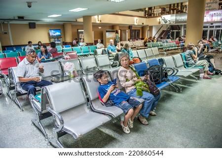 Yangon, Myanmar - March 15,2011: Traveler waiting in departure room of domestic passenger terminal at Yangon international airport, that is the biggest airport of Myanmar. - stock photo