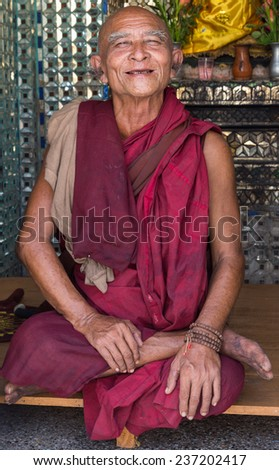 YANGON, MYANMAR - NOVEMBER 22, 2014: an unidentified Buddhist monk goes on pilgrimage to Botataung Pagoda in Yangon, Myanmar.