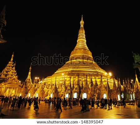 YANGON, MYANMAR - OCT 13: Shwedagon Temple Pagoda in Yangon, Myanmar on October 13, 2011. Shwedagon Pagoda, also known as Great Dagon Pagoda, dates back 2500 years and is 99 meters tall in height.