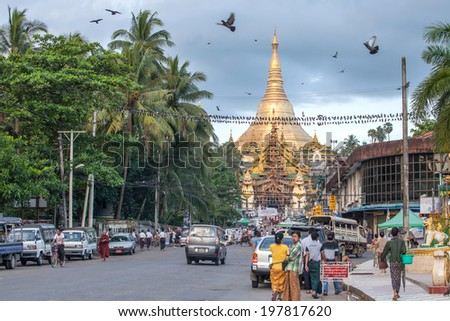 YANGON, MYANMAR - OCTOBER 22 : The way of life in the morning of Burmese at the the east gate of Shwedagon pagoda on October 22,2013 in Yangon, Myanmar. - stock photo