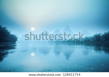 yangshuo scenery in sunrise,tranquil landscape in guilin,China. - stock photo