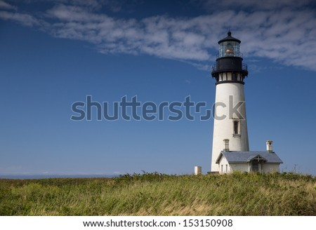 Yaquina Head Black and White Lighthouse With Sea Grass - stock photo