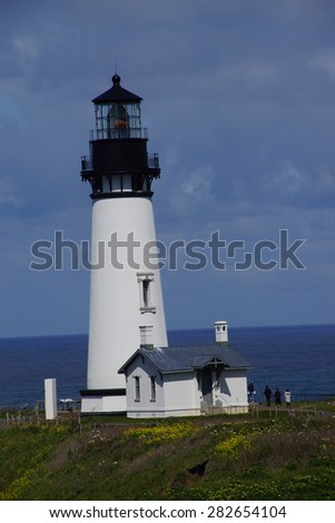 Yaquina Head Lighthouse, with blue sky,  Oregon Coast