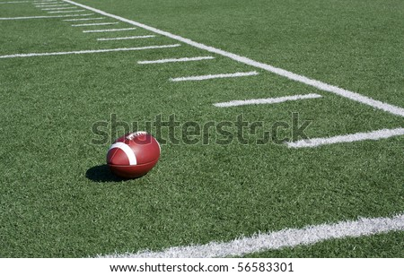 Yard Lines of a Football Field with Ball - stock photo