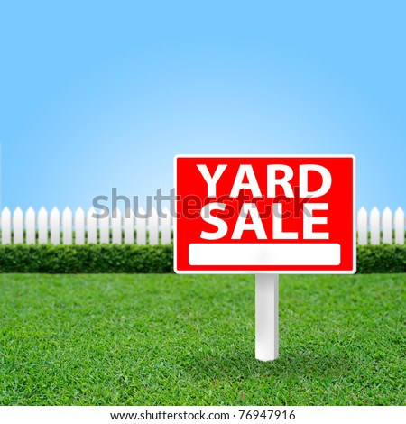 Yard Sale sign on grass field. - stock photo