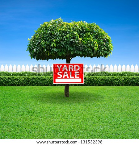 Yard sale sign on tree - stock photo